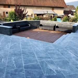 Terrace slabs and steps in Bleu of the Nil marble - Sandblasted finish, wet effect