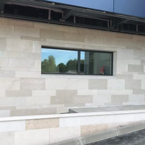 Natural stone facade - mixed finishes