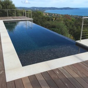 Natural stone coping for this infinity pool
