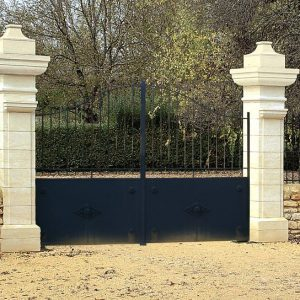 White natural stone portal pillars